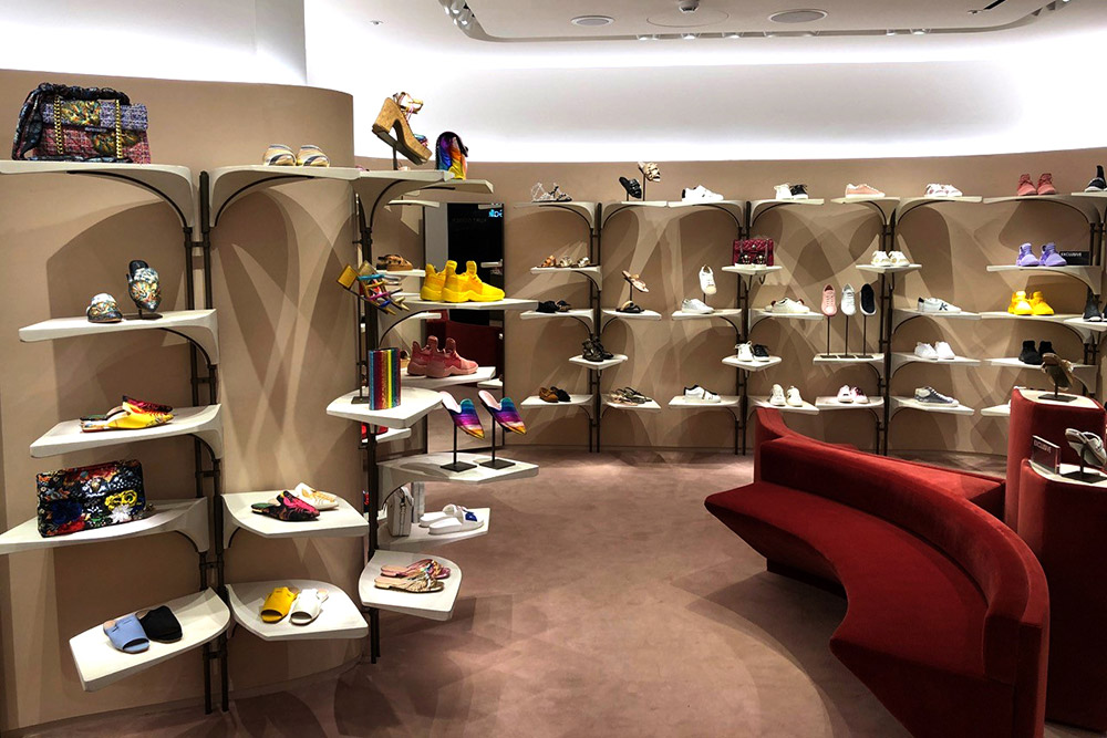 Interior of a shoe shop retail space, with cast jesmonite shelves, the masters of which were created using machined engineered wood
