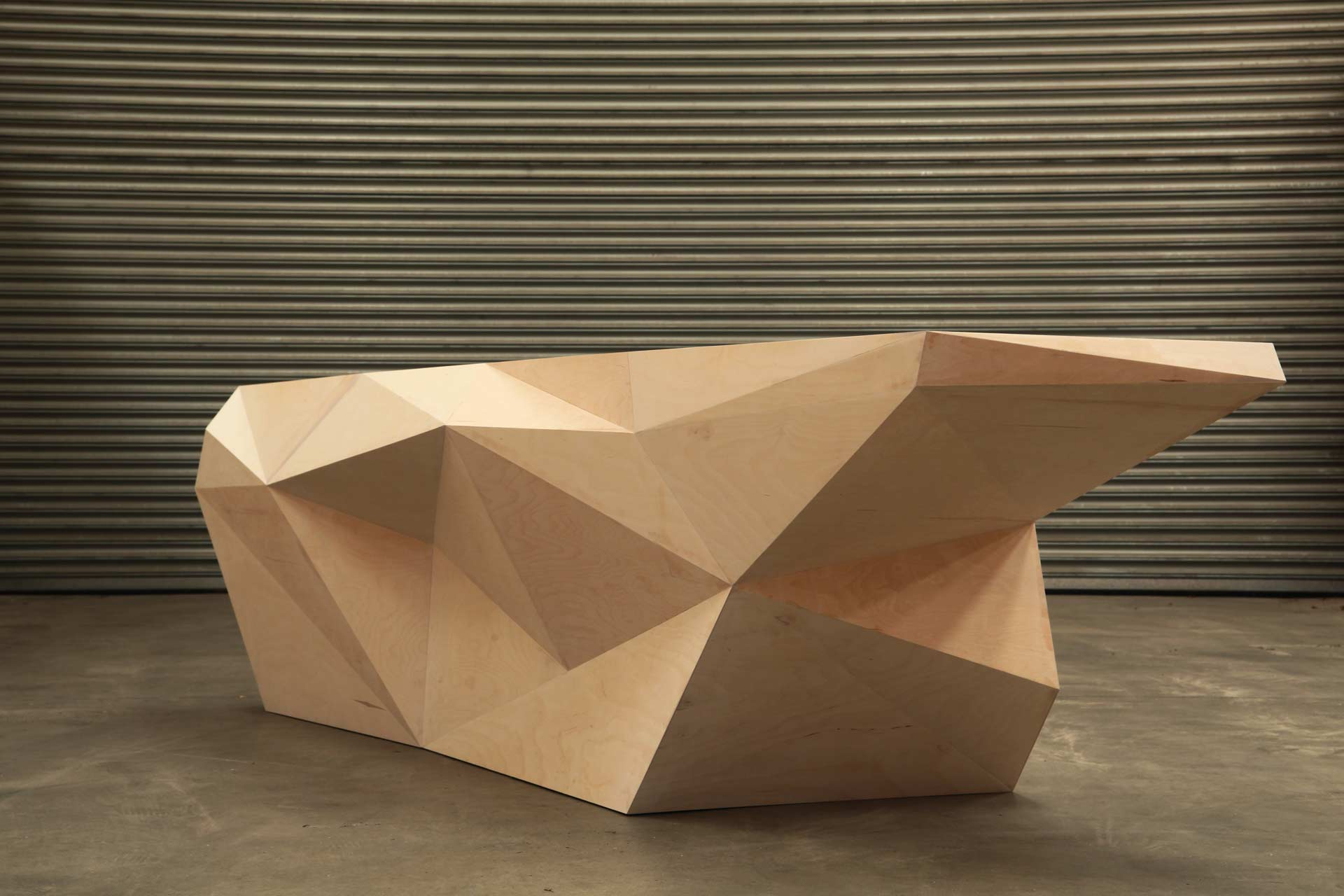 Reception desk constructed from CNC cut plywood panels generated directly from the 3D CAD model