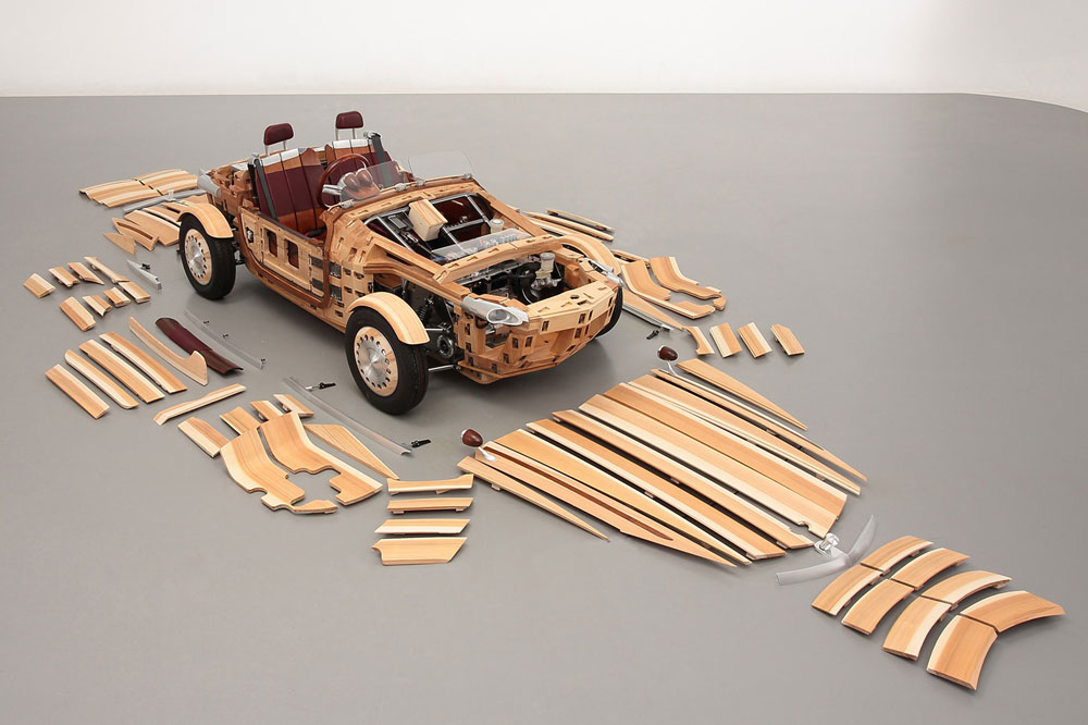 Toyota Setusma wooden concept car with its body panels laid out on the floor